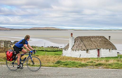 Cyclist at Sollas Cottage, Noorth Uist